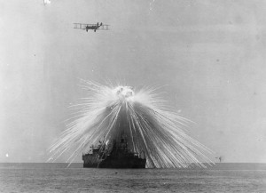 Decommissioned USS Alabama hit by a phosphorous bomb during a test, September, 1921